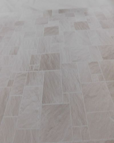 Light stone tile flooring